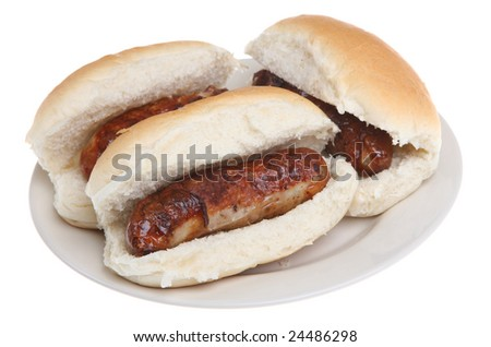 Barbecued sausages in fresh bread rolls - stock photo