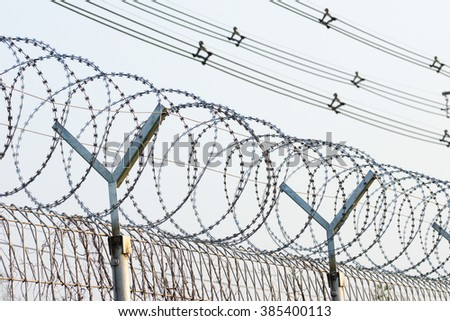 Barbed Razor Wire Fence  - stock photo