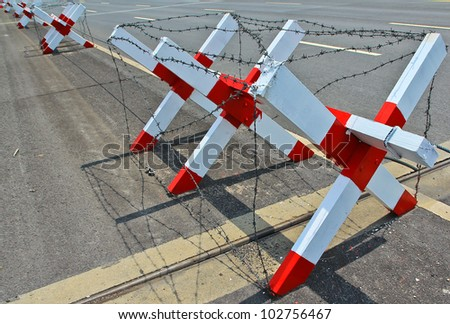 Barbed wire blocking the road. - stock photo