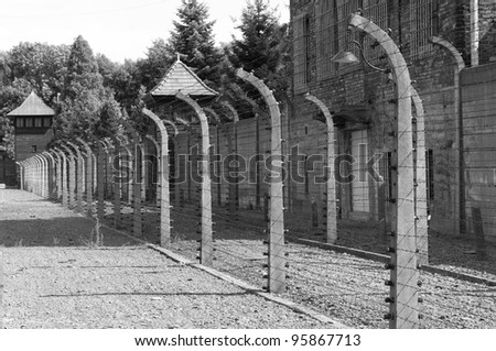Barbed wire electrical fence at Auschwitz concentration camp, Poland - stock photo