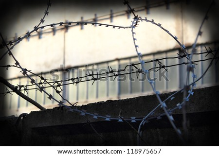 barbed wire on the fence - stock photo