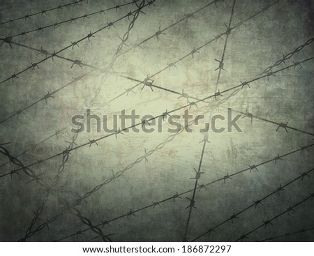 Barbed wire on the texture. - stock photo
