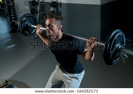Barbell Squat. Young Athlete Doing Barbell Squats - stock photo