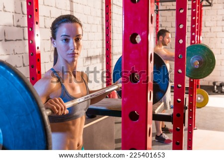 Barbell weight lifting group weightlifting workout exercise gym - stock photo