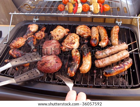 Barbeque just about ready for a  BBQ summer - stock photo