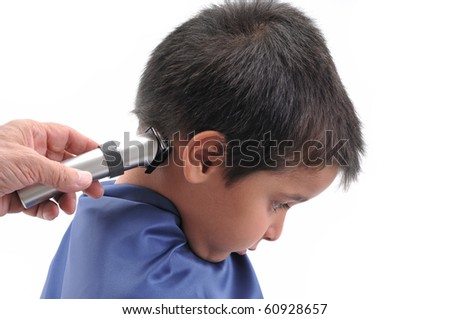 Barber cutting hair with clipper isolated on white background. - stock photo