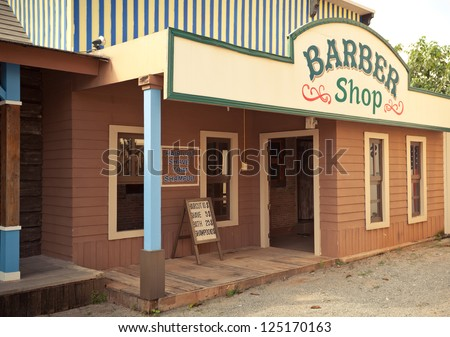 barber in Wild West style in rural - stock photo