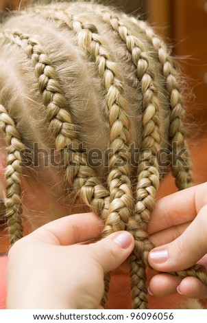 Barber makes the hair girl - stock photo