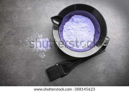 Barber set with hair dye and brush on grey background - stock photo