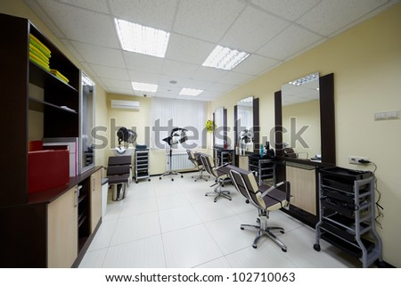 Barbershop cabinet with three working places in the beauty salon - stock photo
