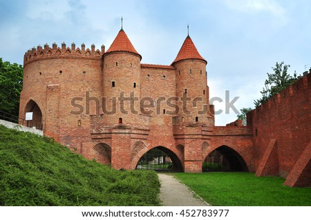 Barbican or Barbakan, historical fortification in Warsaw, Poland - stock photo