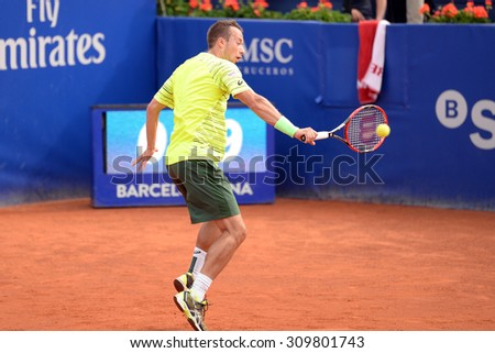 BARCELONA - APR 24: Philipp Kohlschreiber (tennis player from Germany) celebrates a victory at the ATP Barcelona Open Banc Sabadell Conde de Godo tournament on April 24, 2015 in Barcelona, Spain. - stock photo