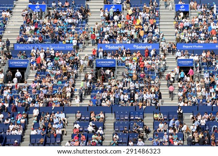 BARCELONA - APR 26: Spectators at the ATP Barcelona Open Banc Sabadell Conde de Godo tournament on April 26, 2015 in Barcelona, Spain. - stock photo