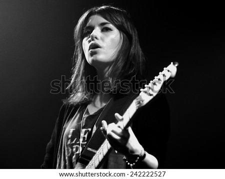 BARCELONA - APR 9: Woman guitarist of Blood Red Shoes (band) performs at Discotheque Razzmatazz on April 9, 2010 in Barcelona, Spain. - stock photo