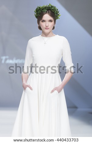 BARCELONA - APRIL 27: a model walks on the Cristina Tamborero bridal collection 2017 catwalk during the Barcelona Bridal Fashion Week runway on April 27, 2016 in Barcelona, Spain.  - stock photo
