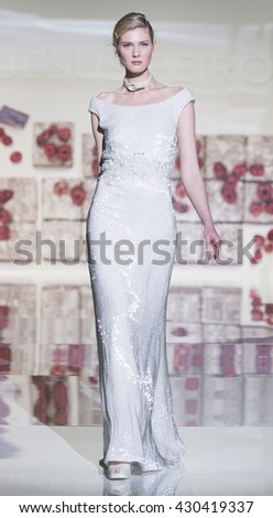 BARCELONA - APRIL 27: a model walks on the Jesus Peiro bridal collection 2017 catwalk during the Barcelona Bridal Fashion Week runway on April 27, 2016 in Barcelona, Spain.  - stock photo