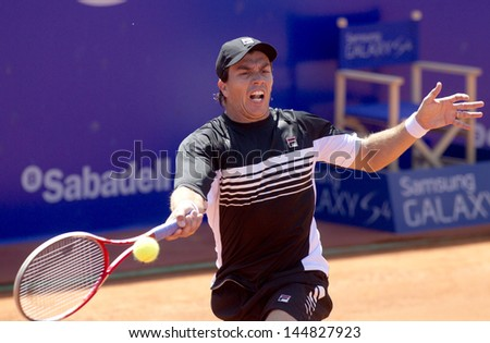 BARCELONA - APRIL, 23: Argentinian tennis player Carlos Berlocq in action during a match of Barcelona tennis tournament Conde de Godo on April 23, 2013 in Barcelona - stock photo