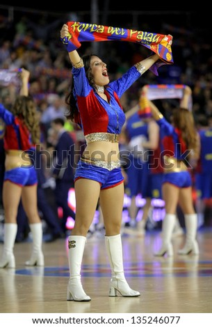 BARCELONA - APRIL, 9: Cheerleader of FC Barcelona in action during a Euroleague match between FC Barcelona vs Panathinaikos at the Palau Blaugrana on April 9, 2013 in Barcelona, Spain - stock photo