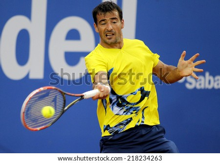 BARCELONA - APRIL, 22: Croatian tennis player Ivan Dodig in action during a match of Barcelona tennis tournament Conde de Godo on April 22, 2014 in Barcelona - stock photo