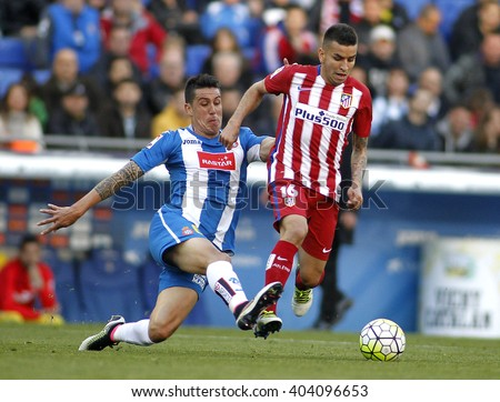 BARCELONA - APRIL, 9: Enzo Roco(L) of RCD Espanyol and Angel Correa(R) of Atletico Madrid during a Spanish League match at the Power8 stadium on April 9, 2016 in Barcelona, Spain - stock photo