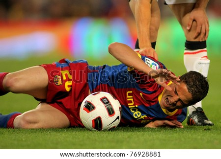 BARCELONA - APRIL 23: Ibrahim Afellay of Barcelona injured during the match between FC Barcelona and Osasuna at the Nou Camp Stadium on April 23, 2011 in Barcelona, Spain - stock photo