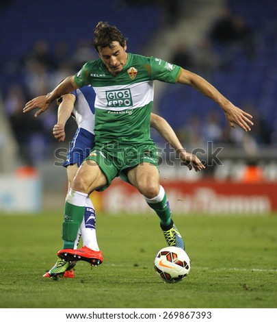 BARCELONA - APRIL, 6: Pedro Mosquera of Elche CF during a Spanish League match against RCD Espanyol at the Estadi Cornella on April 6, 2015 in Barcelona, Spain - stock photo