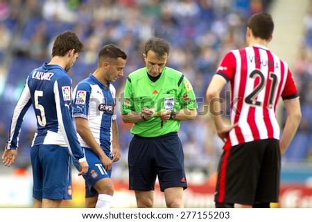 BARCELONA - APRIL, 12: Referee Fernandez Borbalan with players during a Spanish League match between RCD Espanyol and Athletic de Bilbao at the Power8 Stadium on April 12 2015 in Barcelona Spain - stock photo