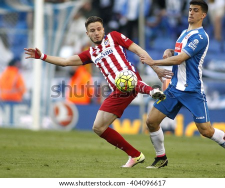 BARCELONA - APRIL, 9: Saul Niguez(L) of Atletico Madrid and Gerard Moreno(R) of RCD Espanyol during a Spanish League match at the Power8 stadium on April 9, 2016 in Barcelona, Spain  - stock photo