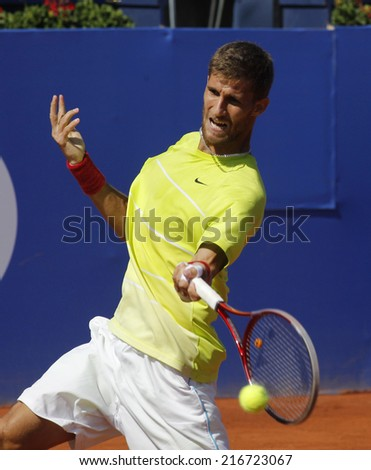 BARCELONA - APRIL, 23: Slovakian tennis player Martin Klizan in action during a match of Barcelona tennis tournament Conde de Godo on April 23, 2014 in Barcelona - stock photo