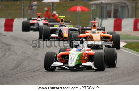 BARCELONA - APRIL 19: Some unidentified drivers racing at the World Series by Renault competition, in the circuit of Catalunya, on April 19, 2009, in Barcelona, Spain. - stock photo