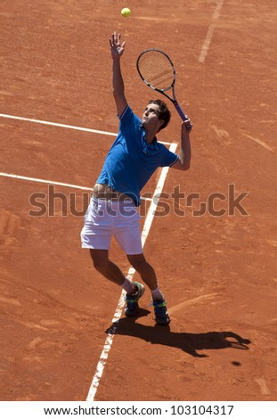 BARCELONA - APRIL, 26: Spanish tennis player Albert Ramos in action during his match against Kei Nishikori of Barcelona tennis tournament Conde de Godo on April 26, 2012 in Barcelona - stock photo