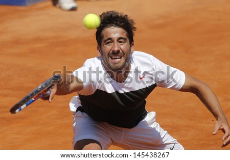 BARCELONA - APRIL, 23: Spanish tennis player Marc Lopez in action during his match against Bernard Tomic of Barcelona tennis tournament Conde de Godo on April 23, 2013 in Barcelona - stock photo
