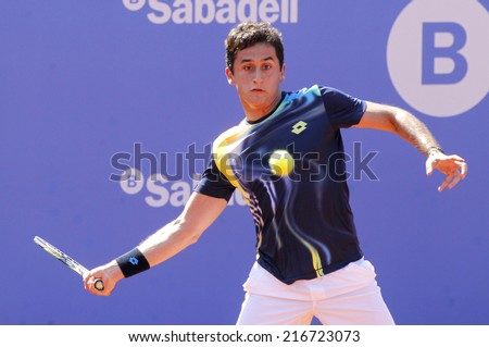 BARCELONA - APRIL, 23: Spanish tennis player Nicolas Almagro in action during a match of Barcelona tennis tournament Conde de Godo on April 23, 2014 in Barcelona - stock photo
