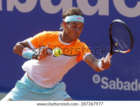 BARCELONA - APRIL, 23: Spanish tennis player Rafa Nadal in action during a match of Barcelona tennis tournament Conde de Godo on April 23 2015 in Barcelona - stock photo