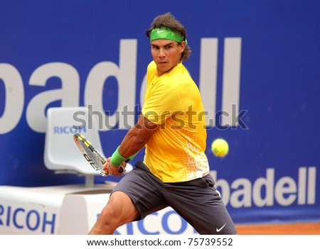 BARCELONA - APRIL 20: Spanish tennis player Rafael Nadal in action during his match against Gimeno-Traver of  Barcelona tennis tournament Conde de Godo on April 20, 2011 in Barcelona, Spain. - stock photo