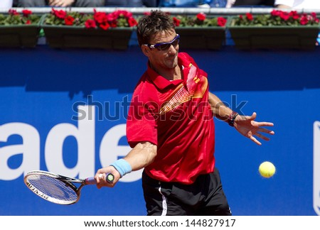 BARCELONA - APRIL, 23: Spanish tennis player Tommy Robredo in action during a match of Barcelona tennis tournament Conde de Godo on April 23, 2013 in Barcelona - stock photo