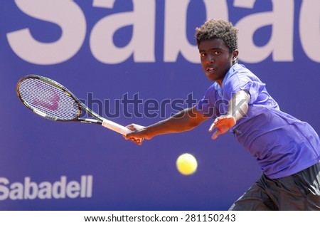 BARCELONA - APRIL, 23: Swedish tennis player Elias Ymer in action during a match of Barcelona tennis tournament Conde de Godo on April 23, 2015 in Barcelona - stock photo