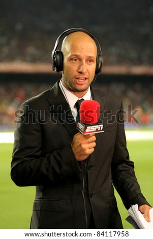 BARCELONA - AUG 17: Martin Ainstein of ESPN reports before the Spanish Supercup football match against FC Barcelona at the New Camp Stadium on August 17, 2011 in Barcelona, Spain - stock photo