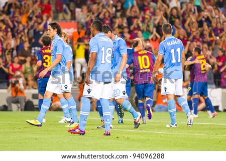 BARCELONA - AUGUST 22: Barcelona players celebrates a goal during the Gamper Trophy final match between FC Barcelona and Napoli, final score 5 - 0, on August 22, 2011 in Camp Nou, Barcelona, Spain. - stock photo