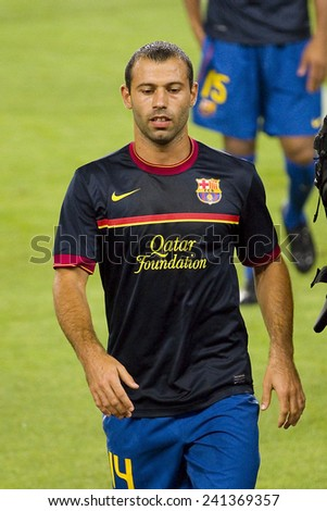 BARCELONA - AUGUST 17: Javier Mascherano of FCB in action at the Spanish Super Cup final match between FC Barcelona and Real Madrid, 3 - 2, on August 17, 2011 in Camp Nou stadium, Barcelona, Spain. - stock photo