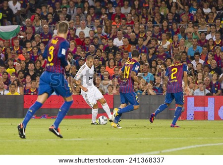 BARCELONA - AUGUST 17: Karim Benzema of RM (middle) in action at the Spanish Super Cup final match between FC Barcelona and Real Madrid, 3 - 2, on August 17, 2011 in Camp Nou, Barcelona, Spain. - stock photo