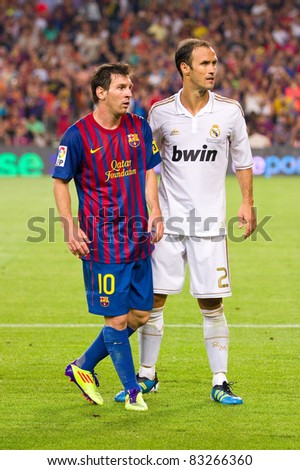 BARCELONA - AUGUST 17: Leo Messi (10) and Ricardo Carvalho during the Spanish Supercup final match between FC Barcelona and Real Madrid, final score 3 - 2, on August 17, 2011 in Barcelona, Spain. - stock photo