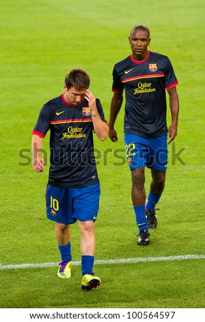BARCELONA - AUGUST 17: Leo Messi (L) and Eric Abidal (R) before the Spanish Super Cup final match between FC Barcelona and Real Madrid, 3 - 2, on August 17, 2011 in Barcelona, Spain. - stock photo