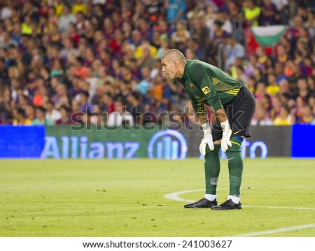 BARCELONA - AUGUST 17: Victor Valdes of FCB in action at the Spanish Super Cup final match between FC Barcelona and Real Madrid, 3 - 2, on August 17, 2011 in Camp Nou stadium, Barcelona, Spain. - stock photo