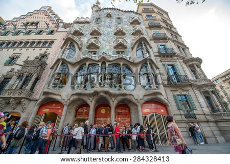 BARCELONA - CIRCA SEPTEMBER 2014: The facade of the house Casa Battlo (also could the house of bones) designed by Antoni Gaudi with his famous expressionistic style - stock photo