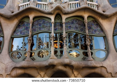 BARCELONA-DEC 9: Gallery glass of Casa Batllo by Gaudi on Dec 9, 2009 in Barcelona. Detail of facade of  Casa Batllo, in Paseo de Gracia street, Barcelona, Catalonia, Spain. - stock photo