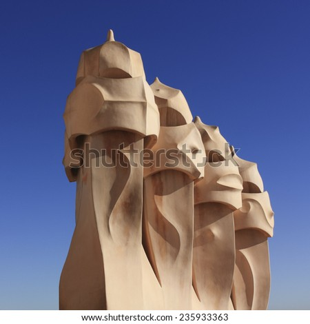 BARCELONA - DEC 9: Gaudi Chimneys at Casa Mila (also called La Pedrera) on Dec 9, 2009 in Barcelona. Terrace of the Casa Mila, with chimneys shaped anthropomorphic soldiers, created by Gaudi. - stock photo