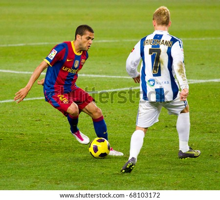 BARCELONA - DECEMBER 13: Dani Alves (2) in action on the soccer field at Nou Camp Stadium. The Spanish team FC Barcelona beat the Real Sociedad, 5-0. December 13, 2010 in Barcelona (Spain). - stock photo