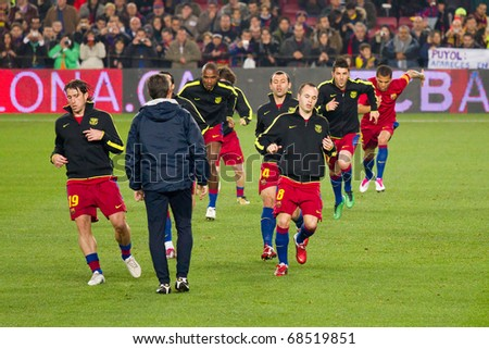 BARCELONA - DECEMBER JUNE 13: Nou Camp stadium, FC Barcelona - Real Sociedad, 5 - 0. In the picture, warm-up of FC Barcelona players before the soccer match. December 13, 2010 in Barcelona (Spain). - stock photo