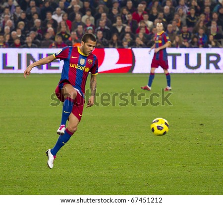 BARCELONA - DECEMBER 13: Nou Camp stadium, Spanish League match: FC Barcelona - Real Sociedad, 5 - 0. In the picture, Dani Alves in action. December 13, 2010 in Barcelona (Spain). - stock photo